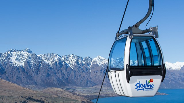 Gondola overlooking Lake Wakatipu and the snowy Remarkables.