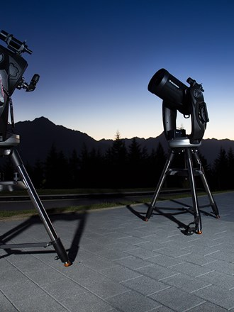 Telescopes set up as the sun goes down over Cecil Peak.