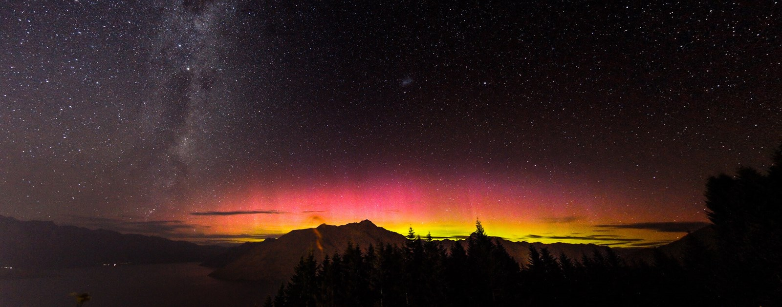 Bright Aurora Australis and the Milky-Way light up the Queenstown sky from Skyline Queenstown.