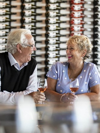 An Older Couple Enjoys A Wine Tasting At The Volcanic Hills Winery, Skyline Rotorua.