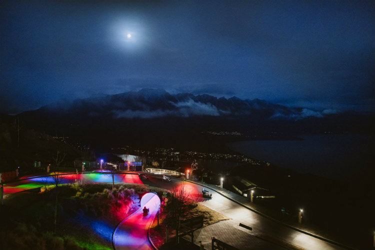 An Aerial Photo Of Both Luge Tracks Illuminated For Night Luging.