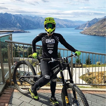 Women standing with her mountain bike ready to ride the downhill bike tracks at Skyline Queenstown.