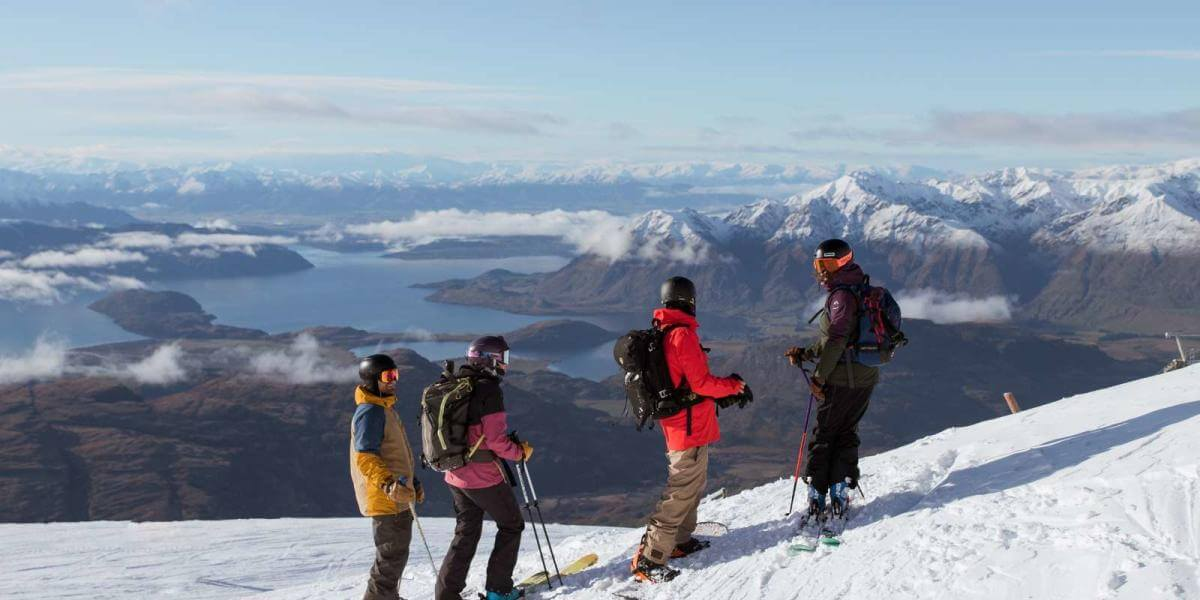 Skiers Looking out over Lake Wanaka.